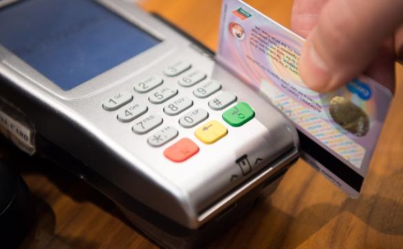 Credit card swiping at a POS machine