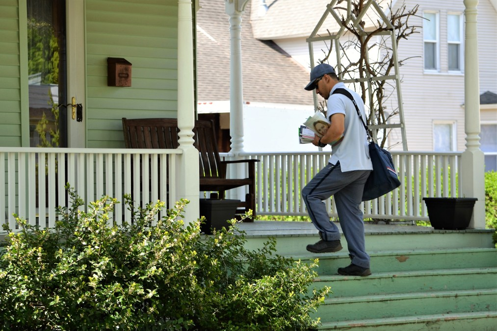 dropping off priority mail at a home