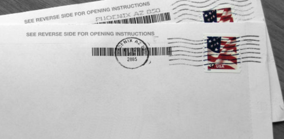 an envelope with stamps