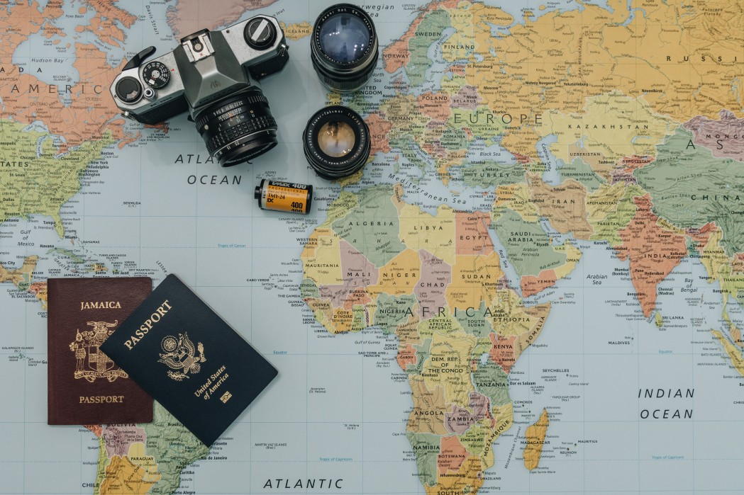 passport and a camera on a map