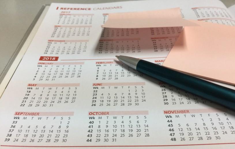 a pen on a calendar