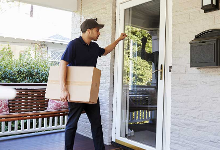 fedex delivery man at the front door