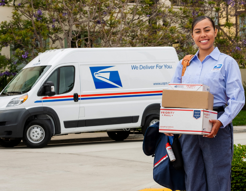 usps delivery driver standing next to usps truck