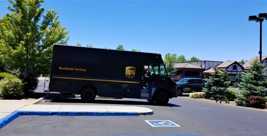 ups driving on a street