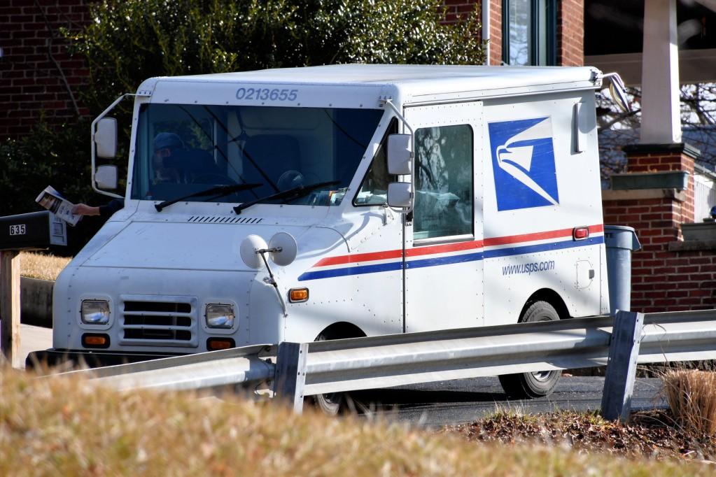 usps truck delivering mail