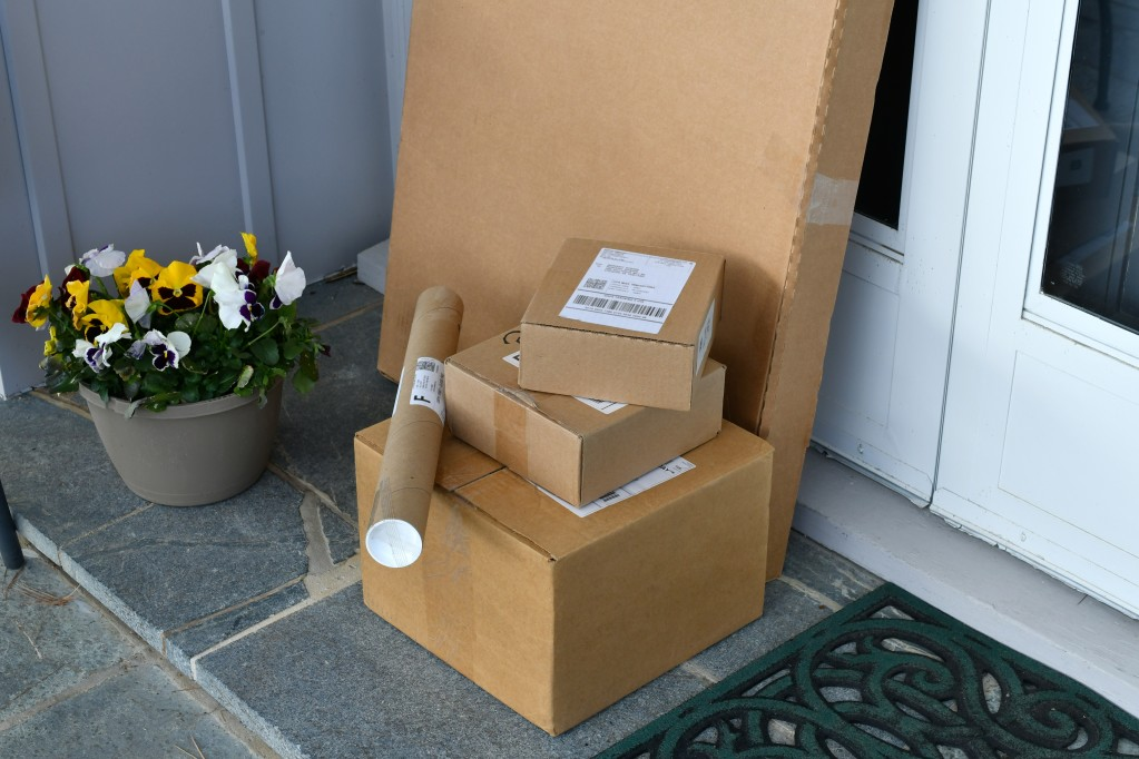 usps packages on the front door