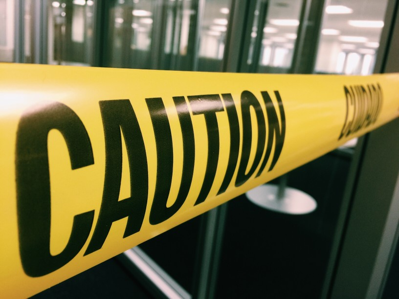 """yellow tape that says """"caution"""""""